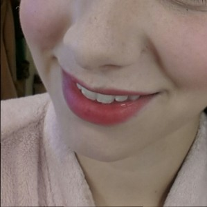 Creme Rouge dabbed on lips